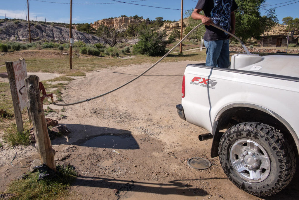 '[The mission is] one of the primary water sources for people in the community. There are people that do not have running water, and do not have electricity, and you know what, it's perfectly fine, they're very happy, we could learn a lot from that. But we have one of the purest aquifers in New Mexico.<br /><br />People come here from all around to get water. And they pay for it, it's on an honor system, they get their water and then they put their money in the little slot in the house over there.  I never double check to make sure everybody pays, I have people that get paid at the beginning of the month so they'll put money in there for the whole month. <br /><br />I would rather people came and got water and left and not worry about paying if they can't pay, I'd rather they have water.'<br /><br />- James, <a href='http://www.lcmmission.org/'>Lybrook Community Ministries</a>