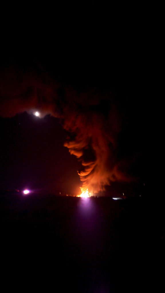 'I got a message pretty late at night, it was after 10, and they said there was a fire at [mile marker] 114. So I'm like, what kind of fire are they talking about? <br /><br />So I went outside and I could start seeing the flames build up, right? Then it kinda smelled weird. I can't describe what the smell was. It was just gross. It wasn't a smell that we usually have in this area. <br /><br />As it kept getting bigger, we were standing outside, and you could hear those containers still popping off, like they were each exploding. That was crazy.'<br /><br />- Kendra, Community Activist<br /><br /><i>Photo Credit: Kendra Pinto</i>