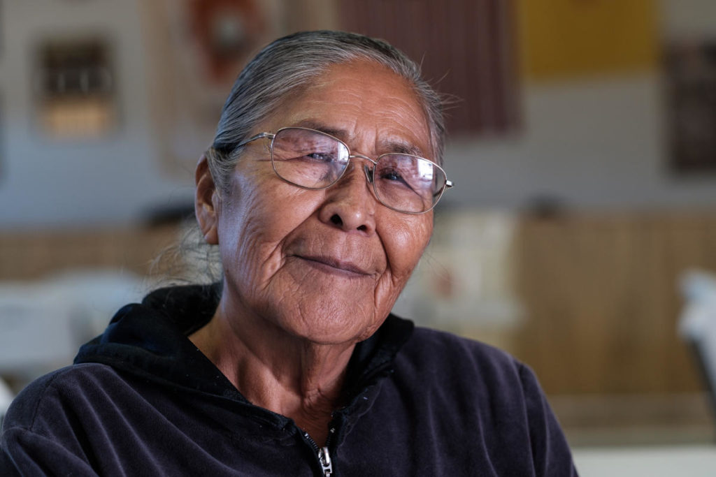 """'They say that was our land, but not anymore. I don't think we have land anymore. It's all theirs. [The companies] can do whatever they want to it and just throw a whole bunch of money to people.""""<br /><br />- Sue, Community Elder"""